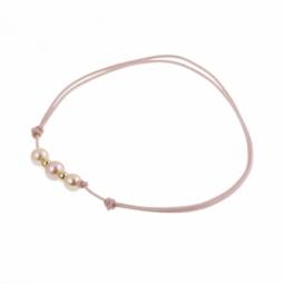 Bracelet en or jaune sur cordon polyester rose et perles de culture