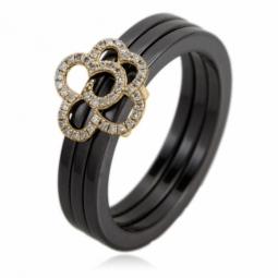 Bague en or jaune, céramique noire, fleur diamants