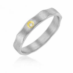 Bague en or jaune et acier , diamant