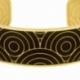 Bracelet jonc en acier doré et motif imprimé - B