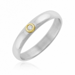 Bague en or jaune et acier, diamant