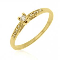 Bague solitaire accompagnée en or jaune diamants serti 4 griffes