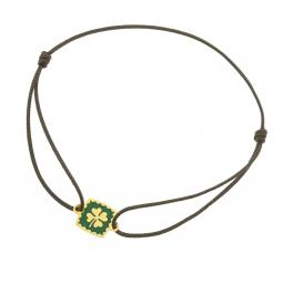 Bracelet en or jaune, cordon et laque, trèfle